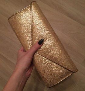Клатч ALDO золотистого цвета