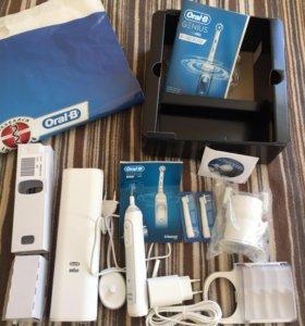 Электрическая зубная щётка oral b