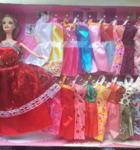 Кукла новая с одеждой
