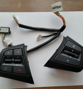 Кнопки управления на руль.