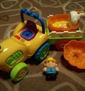Игрушка трактор, ездит и играет музыку