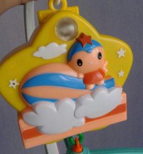 Детская игрушка на кроватку