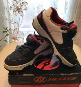 Heelys ( кроссовки с колесиками)