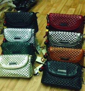 Кожаные сумки и клатч