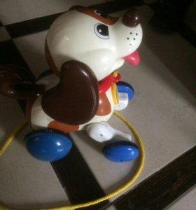 Игрушка-каталка собака
