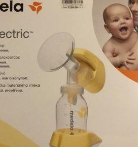 Молокоотсос электрический Medela+пакеты для молока