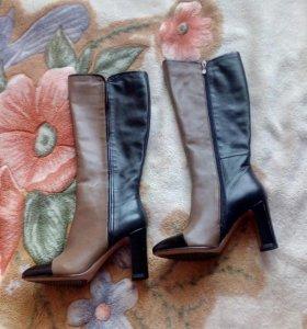Новые кожаные сапоги.