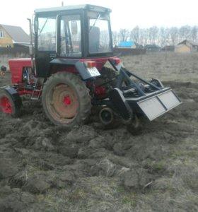 Обработка земли мини трактором