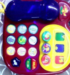 Детский игрушечный телефон