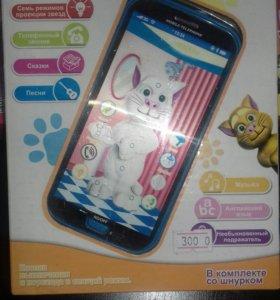 Продам детскую игрушку айфон
