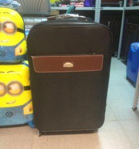 Тканевый чемодан на 4 колесах