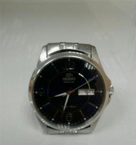 Часы Orient em7