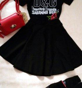 Новая юбка черного цвета.