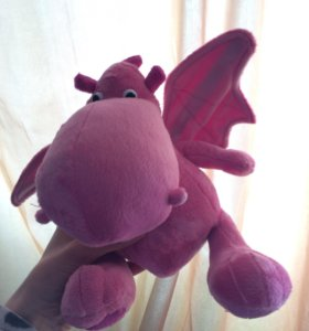 Детская игрушка динозавр