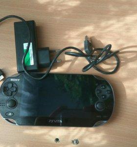 PS Vita с зарядкой
