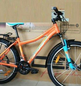 Женский велосипед с крыльями и багажником новый