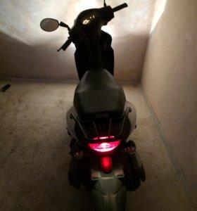 Скутер Sym