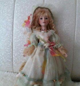 Продам куклу декоративную.