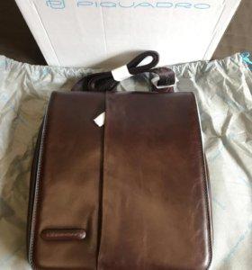 Кожаная сумка с закидным карманом Piquadro.