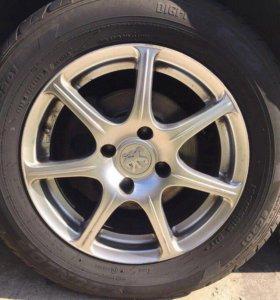 Комплект шин Dunlop и дисков Peugeot