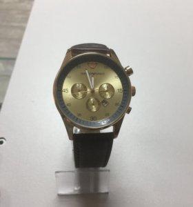 Часы E A