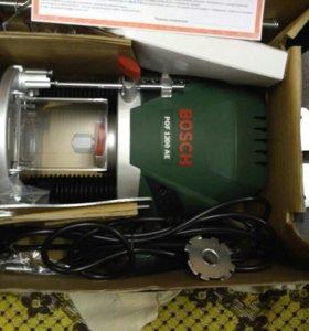 Вертикальная фрезерная машина Bosch POF 1200 AE 0.