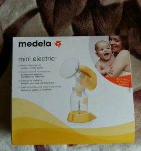Электрический молокоотсос Медела