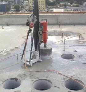 Сверление отверстий в бетоне и кирпиче.