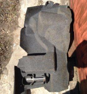Обшивка багажника bmw