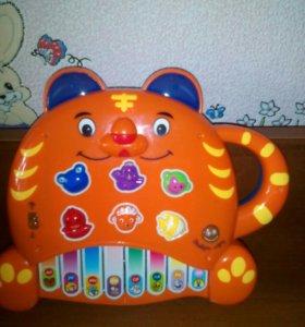 Развивающая интерактивная музыкальная игрушка.