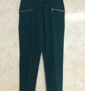 Продам зеленые брюки