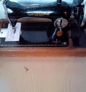 Швейная машина .