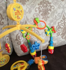 Игрушки в кроватку и коляску