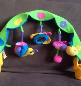 Игрушки на коляску для малышей.