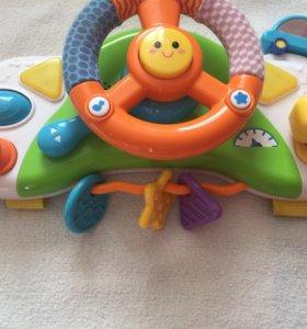 Игрушка на коляску руль