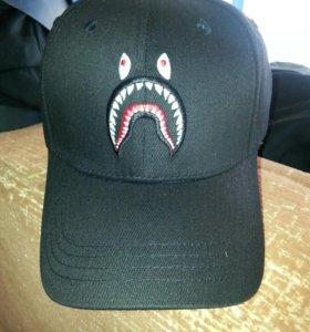 Новые кепки.