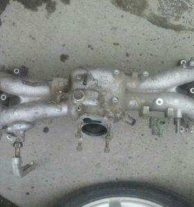 Коллектор впускной на Subaru Legacy ej20