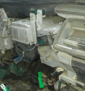 Радиатор печки Mazda capella