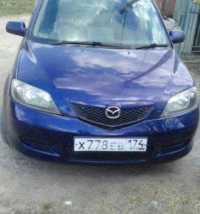 Автомобиль Мазда Демио