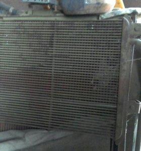 Радиатор т150