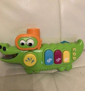 Крокодил музыкальная игрушка