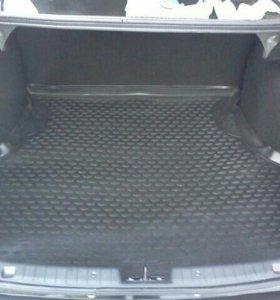 Продам резиновые коврики в багажник