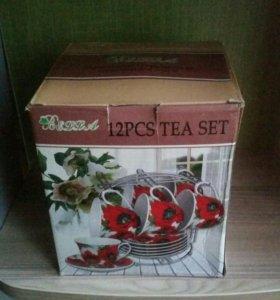 Новый чайный набор на металлической подставке.