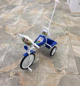 Новый велосипед малыш с ручкой.