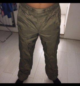 Утеплённые спортивные штаны Reebok зеленого цвета