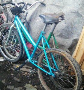 Велосипеды и запчасти.
