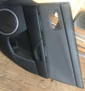 Обшивка задней правой двери Mazda 3 седан bk
