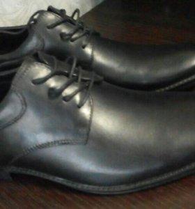 Продаю мужские туфли новые кожа