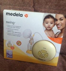 Молокоотсос Medela swing + подарки