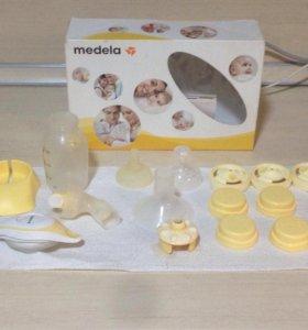 Medela молокоотсос и стерилизатор